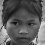 Lotus girl waiting to receive her uniform and text books - © Luis Murillo/Lotus Educational Fund