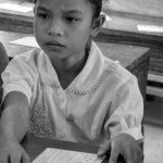 Lotus girls in Grade 1 receive a uniform and text books - © Luis Murillo/Lotus Educational Fund