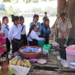 Teacher Ajan prepares lunch for some of the secondary girls.